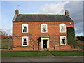 Dates from about 1830 http://www.britishlistedbuildings.co.uk/en-193891-corner-house-allington-lincolnshire#.VvmjAEfkoeU