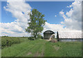 SP7908 : Barn and Shed by the Footpath by Des Blenkinsopp