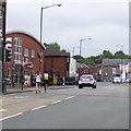 SJ9594 : Hyde 7 Road Race: Passing Hatton Fitness Centre by Gerald England