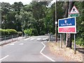 SZ0792 : Talbot Woods: Talbot Heath School drive and signpost for footpath A17 by Chris Downer