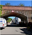 """Headroom is shown as 14' 6"""" under the markers. The bridge carries the Avocet Line railway near the village station."""