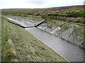 SD9815 : Ripples and weir on the catchment drain, Rishworth by Humphrey Bolton