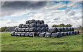 SO9828 : Silage bales by the bridleway  by David P Howard