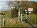 NS4374 : The Crags Circular Path leaving a farm road by Lairich Rig