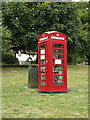 TL8720 : Telephone Box Library on The Green by Adrian Cable