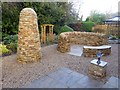 NY9363 : Stone cairn and bench by Oliver Dixon