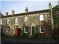 SE0749 : Terraced housing on Main Street, Addingham by JThomas