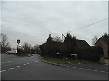 TL0046 : Wood End Lane at the junction of Tithe Road by David Howard