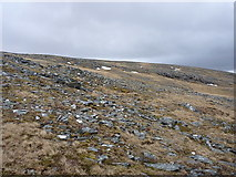 NG9773 : Scattered boulders and debris high in Coir' an Taoibh Riabhaich by Richard Law
