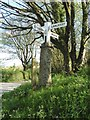 SX0759 : Signpost by the Saints' Way near Lanlivery by Dave Kelly