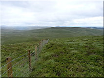 SH9219 : Fenceline down to Mynydd Coch by Richard Law