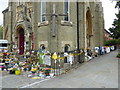 TQ2481 : Flowers and tributes outside Notting Hill Methodist Church by Marathon
