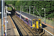 NT1768 : Train at Curriehill Station by Anne Burgess