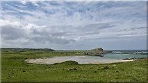 NR3593 : View over Traigh an Tobair Fhuair to Dun Ghallain fort by Julian Paren
