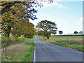 TL1266 : Road heading west from Dillington by Robin Webster