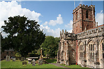 ST1436 : Crowcombe: Crowcombe church and cross by Martin Bodman