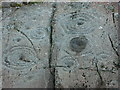 NR8390 : Cup and Ring markings on inscribed stone by Chris Hawkes
