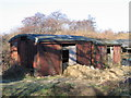 TG3103 : Goods vans used as sheds at Low Common by Graham Hardy