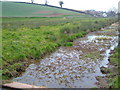 Dist:0.3km<br/>At the eastern side of the square, this channel drains the marsh. View to NE from footpath.