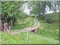 NY6167 : Farm road to Breckney Bed by Oliver Dixon