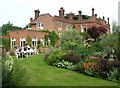 TG1904 : Intwood Hall - west face and conservatory from the garden by Katy Walters