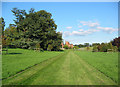 SJ5844 : View towards Combermere Abbey cottages by Espresso Addict
