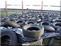 SM8832 : Old tyres on silage clamp by ceridwen