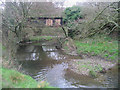 SY5797 : Disused railway bridge and River Hooke by Maurice D Budden