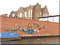 TQ2581 : Canalside mural from litter by David Hawgood