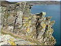 SX1550 : Pencarrow Head cliffside rocks by Brian