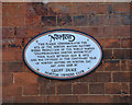 Photo of Norton Motor Cycle Company white plaque