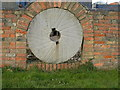 TL1157 : Mill Stone in a Wall by Carl Jones