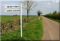 SP5731 : Signs on the road near Cottisford by Martin Loader