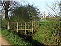 TF2960 : Footbridge and path to Revesby Abbey Earthworks by Dave Hitchborne