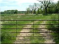 SP6335 : Gate and footpath by Snidge