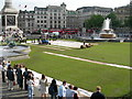 More than 2000 square metres of turf was laid down in Trafalgar Square on Thursday 24th May 2007 as part of a campaign to promote green spaces and villages in London. After two days it is now being taken up to be moved to Bishops Park in Fulham. 