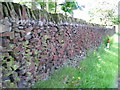 SE0342 : Red-coloured dry stone wall along Redcar Lane by John Readman