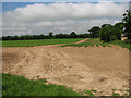 TG2226 : Field by the roadside by Evelyn Simak