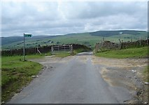 SS9686 : Junction of two footpaths with road by Ruth Sharville