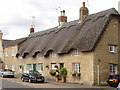 SP9462 : Thatched cottages in Podington by David Hawgood