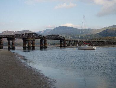 SH6115 : SH6115 Barmouth Bridge from a sand bank by David Bowen