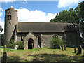 TG3511 : All Saints Church - view across churchyard by Evelyn Simak