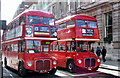 A pair of Routemasters on Whitehall at Trafalgar Square. One of the buses is going to Neverland!