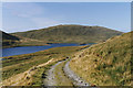 SN7687 : The water-board track above Nant-y-moch reservoir by Nigel Brown