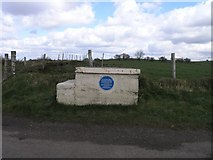 SN5108 : Milk churn stand with blue plaque... by Hywel Williams