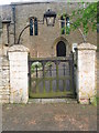 TL0998 : Church Yard Gateway, Sutton by Michael Trolove