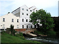 TG2322 : The former Buxton Water Mill - mill race by Evelyn Simak