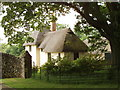 SU7595 : Thatched lodge on Wormsley estate by David Hawgood