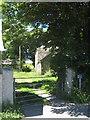 SW7229 : Footpath through Trebarvah Goodnow farmyard by Rod Allday