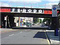 Dist:0.1km<br/>The North London line crossing the Caledonian Road. The bridge retains the traditional Ferodo advert which was a feature of many bridges.